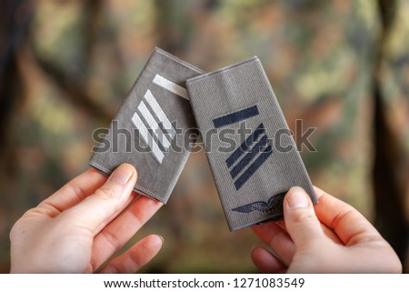 german shoulder ranks on a camouflage background #1271083549