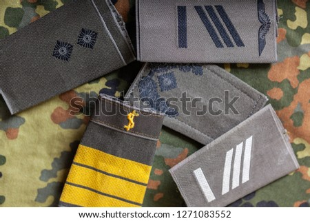 german shoulder ranks on a camouflage background #1271083552