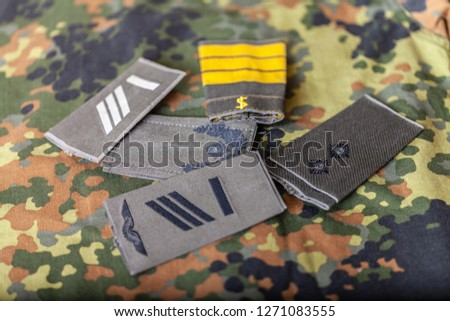 german shoulder ranks on a camouflage background #1271083555