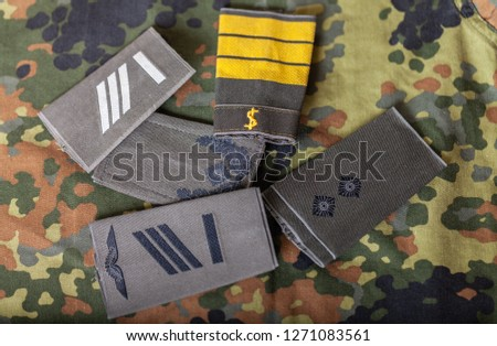 german shoulder ranks on a camouflage background #1271083561