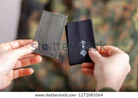 german shoulder ranks on a camouflage background #1271083564