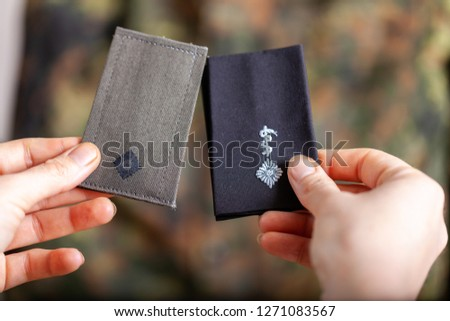 german shoulder ranks on a camouflage background #1271083567