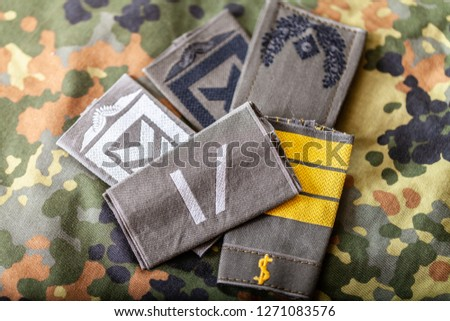 german shoulder ranks on a camouflage background #1271083576