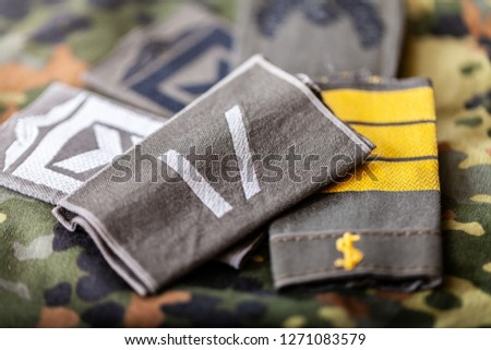 german shoulder ranks on a camouflage background #1271083579