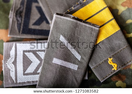 german shoulder ranks on a camouflage background #1271083582
