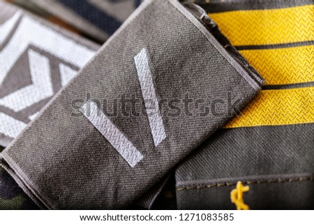 german shoulder ranks on a camouflage background #1271083585