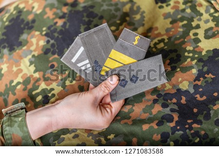 german shoulder ranks on a camouflage background #1271083588