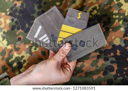 german shoulder ranks on a camouflage background #1271083591