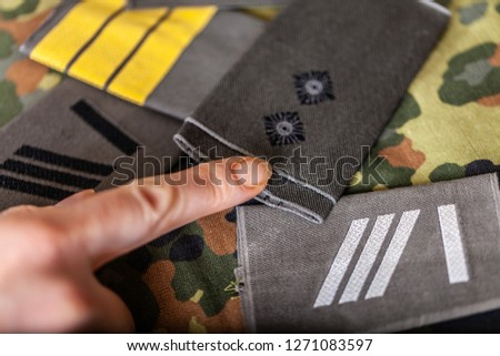 german shoulder ranks on a camouflage background #1271083597