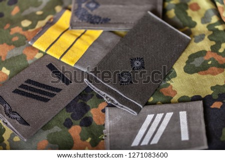 german shoulder ranks on a camouflage background #1271083600