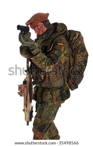 German soldier with the weapon and pistol.