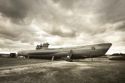 German submarine U-995. Dramatic sky, storm clouds. Museum ship, Laboe Naval Memorial. Germany. Panoramic view, sepia image effect. Landmarks, sightseeing, history, past, war, WW2, nautical vessel