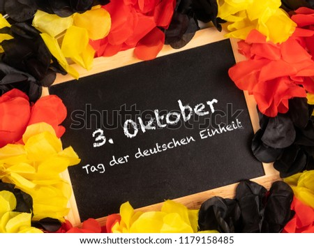 German Text 3. Oktober Tag der deutschen Einheit, in english, 3. October, day of german unity with national colors