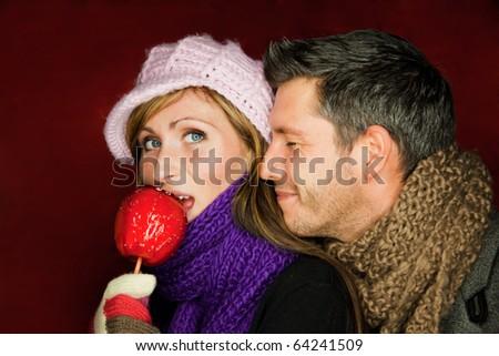 German traditional christmas market couple eating red taffy apple