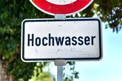 German water flood sign at Rhine river saying 'Hochwasser'