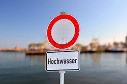 German water flood sign with red circle and text saying 'Hochwasser'