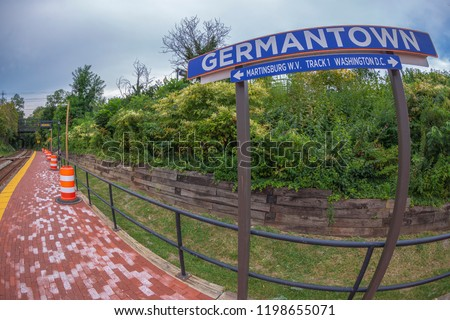 GERMANTOWN, USA - AUGUST 30, 2018: Direction sign in railway station. One city in Montgomery County, Maryland, located approximately 25–30 miles outside of the U.S. capital of Washington, D.C.