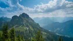 Germany, Allgaeu, Aggenstein, Impressive high mountain view from above, countless green trees covering nature scenery