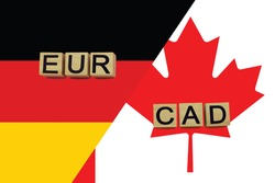Germany and Canada currencies codes on national flags background. International money transfer concept