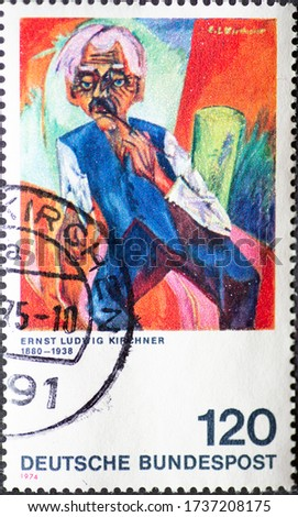 GERMANY - CIRCA 1974: a postage stamp printed in Germany showing an old farmer. Text: Ernst Ludwig Kirchner