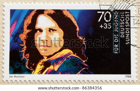 GERMANY - CIRCA 1988. A postage stamp printed in Germany shows image portrait of famous American singer and poet Jim Morrison (James Douglas Morrison, 1943-1971), circa 1988.
