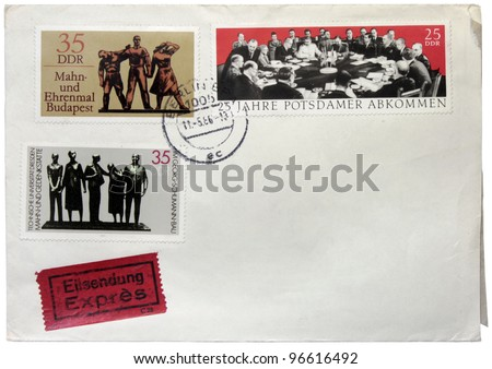 GERMANY - CIRCA 1986: a set of three stamps printed by German Democratic Republic shows picture of Potsdam Conference session and Willi Lammert sculptures, circa 1986