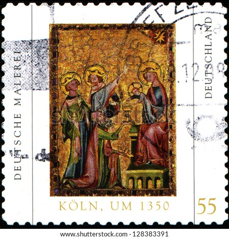 GERMANY - CIRCA 2008: A stamp printed in German Federal Republic shows painting created in 1350 for Cologne convent of St. Clare of a Cologne workshop , depicts Magi to adore Child Jesus, circa 2008