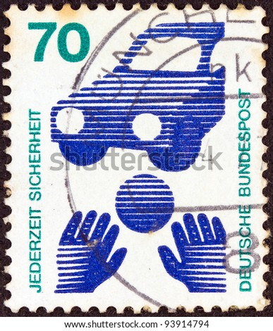 """GERMANY - CIRCA 1971: A stamp printed in Germany from the """"Accident Prevention"""" issue shows a ball in front of a car (Child Road Safety), circa 1971."""