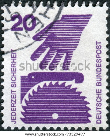 GERMANY - CIRCA 1972: A stamp printed in Germany, is dedicated to Accident prevention shows the Hand and circular saw, circa 1972