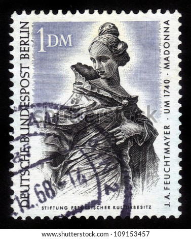 Germany - CIRCA 1968: A stamp printed in Germany shows a portrait of madonna by Joseph Anton Feuchtmayer, circa 1968