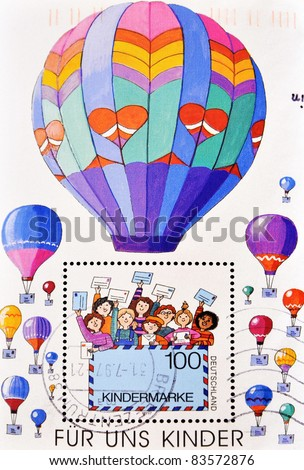 GERMANY - CIRCA 2002: A stamp printed in Germany shows picture of children with cards and balloons, circa 2002