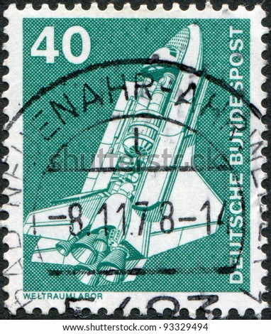 GERMANY - CIRCA 1975: A stamp printed in Germany, shows the space shuttle, circa 1975 - stock photo