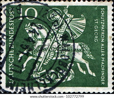 GERMANY - CIRCA 1961: A stamp printed in the German Ferderal Republic shows St. George Killing the Dragon, patron saint of Boy Scouts, circa 1961
