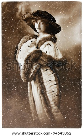 GERMANY - CIRCA 1906: a vintage postcard printed by GERMANY shows sepia toning photograph of beautiful lady in fashion fur, circa 1906.