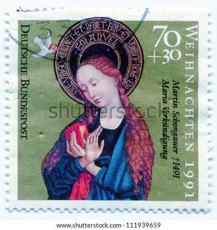 GERMANY, CIRCA 1991: Madonna with Jesus child on postage stamp, circa 1991