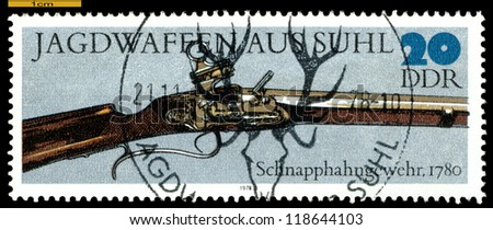 GERMANY - CIRCA 1978: post stamps printed in Germany,  shows  antique  Spring-cock  Gun. 1780,  Hunting Guns series, circa 1978