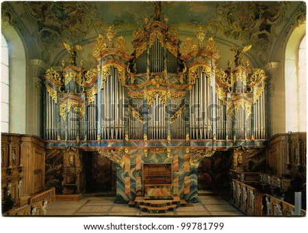 GERMANY  - CIRCA 1989: Postcard printed in Germany shows Historical Organ in the abbey church Fischingen, circa 1989