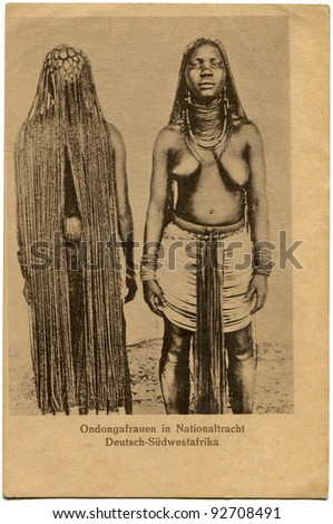 GERMANY - CIRCA 1901: Reproduction of antique postcard issued by the German colonial propaganda bureau shows woman, circa 1901 German text: Ondongo woman in national costume, German South Africa