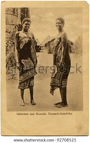 GERMANY - CIRCA 1901: Reproduction of antique postcard issued by the German colonial propaganda bureau shows two womans, circa 1901 Germant text:  ladies from Rwanda, German South Africa