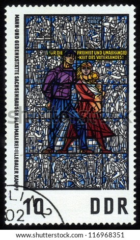 GERMANY - CIRCA 1968 stamp printed in East Germany, shows  Sachsenhausen Memorial Museum , windows of  triptych of Museum of anti-fascist resistance of  European peoples by Walter Womacka ,circa 1968.
