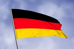 Germany flag isolated on sky background. close up waving flag of Germany. flag symbols of Germany.