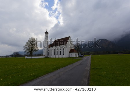 GERMANY - Fuessen ; 01 MAY 2016  famous St. Coloman church in beautiful morning with flower field in summer, Bavaria, Germany #427180213