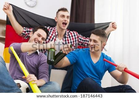 Germany men celebrating win of favorite football team - Shutterstock ID 187146443