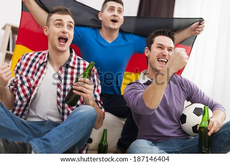 Germany men cheering football match  - Shutterstock ID 187146404
