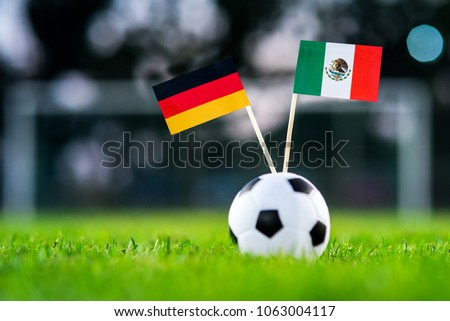 Germany - Mexico, Group F, Sunday, 17. June, Football, World Cup, Russia 2018, National Flags on green grass, white football ball on ground. #1063004117