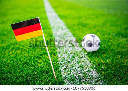 Germany national Flag and football ball on green grass. Fans, support photo, edit space.  #1077530936