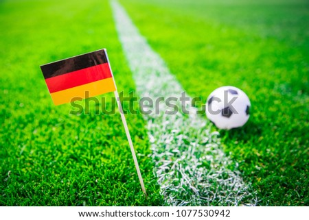 Germany national Flag and football ball on green grass. Fans, support photo, edit space.  #1077530942
