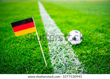 Germany national Flag and football ball on green grass. Fans, support photo, edit space.   #1077530945