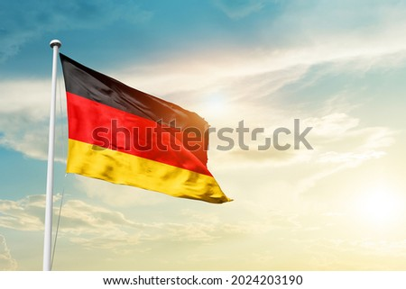 Germany national flag waving in beautiful clouds. Photo stock ©