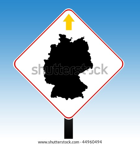 Germany road sign in colors of flag with directional arrow, blue sky background.